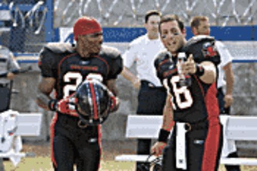 Personal foul: Adam Sandler (right, with Nelly) is no Burt Reynolds in the remake of The Longest Yard.