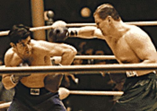Raging Crowe: Russell Crowe (left, with Art Binkowski) gives a memorable portrayal of fighter James Braddock in Cinderella Man.