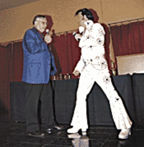 An Elvis impersonator with Joe at his roast. The real Presley toured FBI headquarters in 1970, but Arpaio's mentor, Hoover, wouldn't meet with the King.