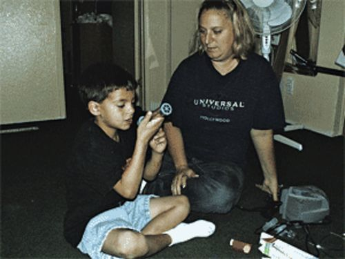 Jonathan Hendrix and his mom Jennifer test his lung capacity.
