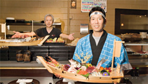 "What a catch: Chef Kazuto Kishino (left) and sushi chef Rick ""Koji"" Hashimoto show off the seafood at Hana."