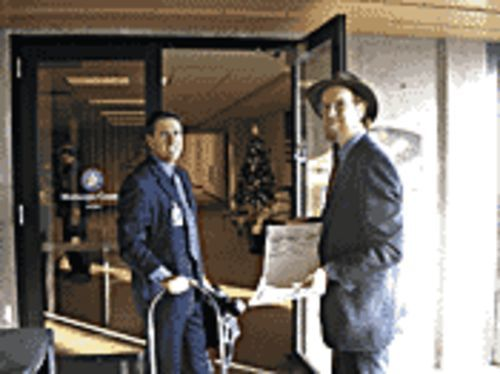 Senator Jack Harper (left) and Douglas Jones prepare to inspect Maricopa County's voting machines.