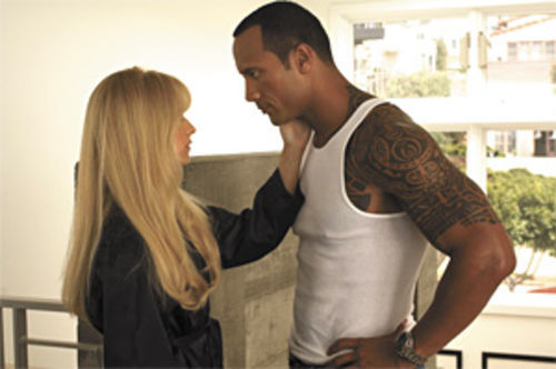 Doomsday love: Sarah Michelle Gellar and Dwayne Johnson carry on a post-apocalyptic tabloid romance in Southland Tales.