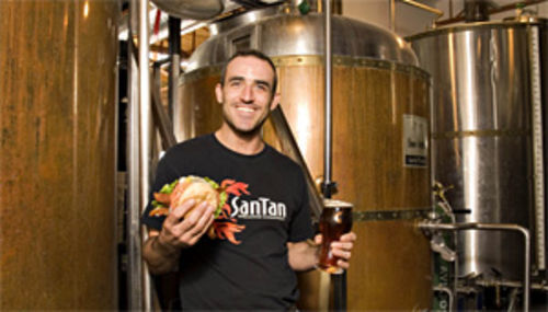 He's a stout young man: SanTan's head brewer/owner Anthony Canecchia grabs a burger and a pint of Gordo Stout.