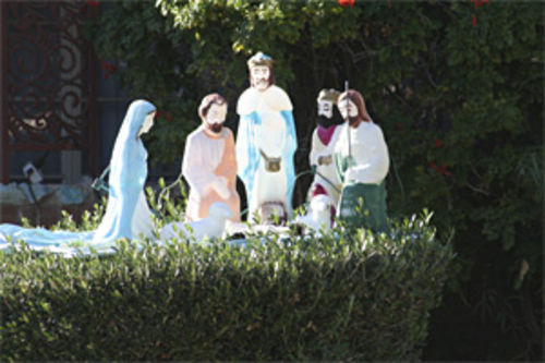 Nothing says Christmas like baby Jesus on a hedge.