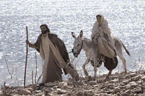 Hauling ass: Joseph (Oscar Isaac)  and Mary (Keisha Castle-Hughes) hit the road in The Nativity Story.