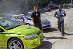 Hot wheels: Paul Walker and Tyrese stand alongside the true stars of 2 Fast 2 Furious.