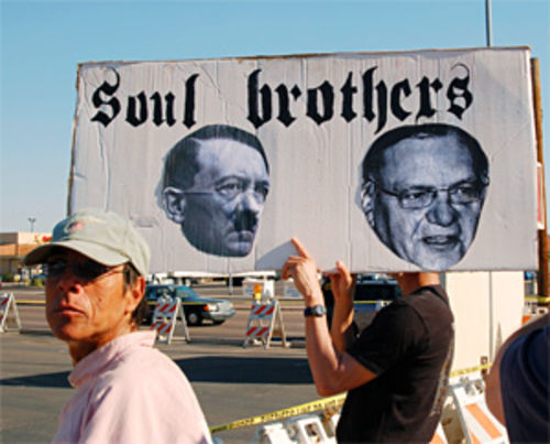 Separated at birth? Adolf and Arpaio share space on a protester's placard at the Bell Road brouhaha.