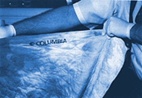 A police photograph shows the Columbia Medical Center bedding that accompanied the body of Dominic Marion to Heritage Funeral Chapel.