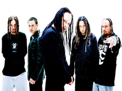 "After bandmate Brian Welch (left) quit Korn, singer Jonathan Davis (center) wrote on his blog: ""I'm done with your false crusade."""
