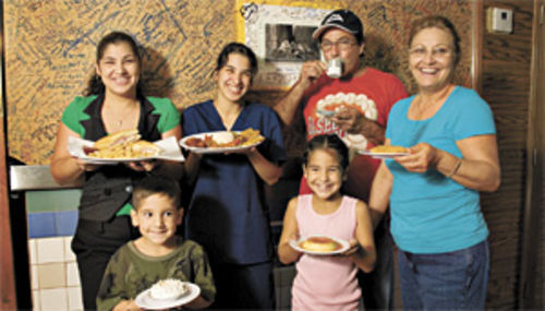 Family style: (From right) Sabor Cubano owners Nancy Socarras and Eduardo Carralero serve up home cooking with daughters Anna and Sandra, and grandkids Roxanna and Jesus.