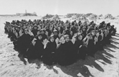 A sea of women in chadors fills the desert in Shirin Neshat's Rapture.