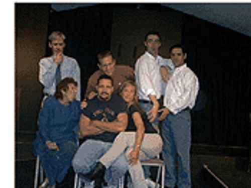 All in a Nutshell: Standing (from left) Philip M. Wright, Marc Burton, Michael Peck and Dion Foreman; sitting (from left) Lu Richards, Joe Marshall, April Shepherd.