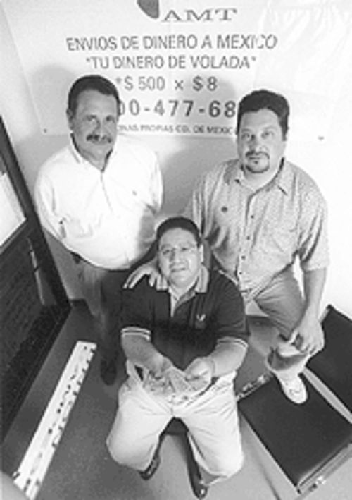 Tony Tercero (left) and Michael Nowakowski (right) of  La Campesina, with Pete Guerrero of American Money  Transfer.