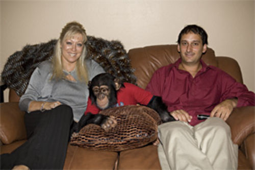 Kristy Pruett and ex-husband Andrew snuggle with Joey in their Northwest Valley home.