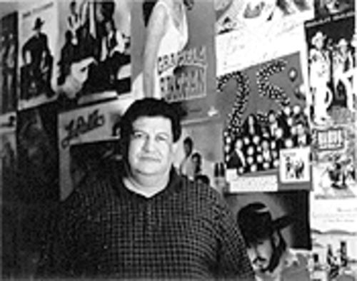 Monreal in his garage, which is filled with posters of the bands for whom he's written.