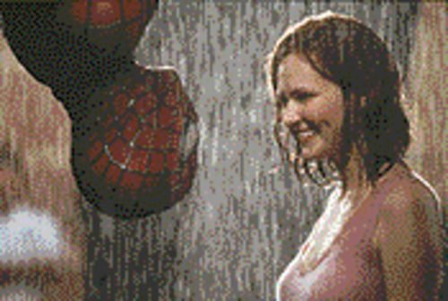 Spider sense: Tobey Maguire and Kirsten Dunst see eye-to-eye as a couple of pretty believable comic-book heroes in Sam Raimi's Spider-Man.