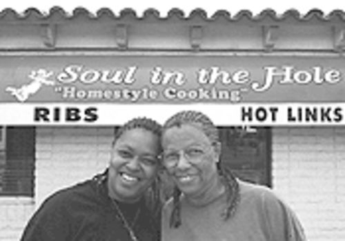 Soul in the Hole owner Tonia Lopez (left) cooks with her mother, Frances Gilbert.