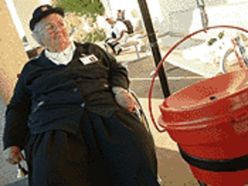 From whom the bell tolls: Salvation Army soldier May Showers stays in the ring of things.