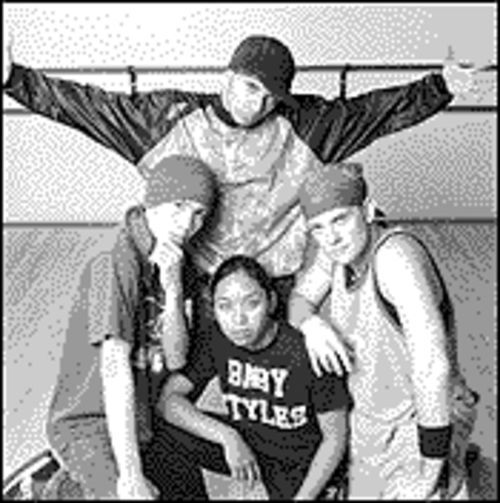 House (standing) and members of the Furious Styles Crew.