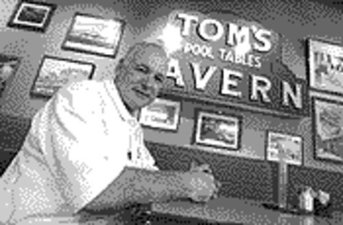 Michael Ratner, one of the owners of Tom's Tavern. His restaurant is one of the few downtown to stay open past five.