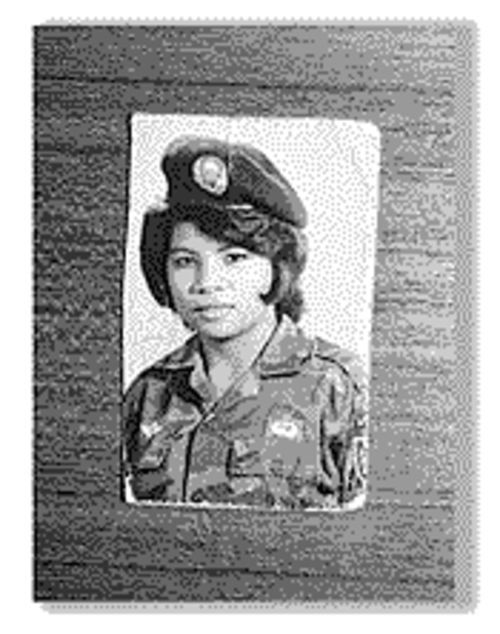Dung Chau's mother, Mai, donned the uniform of his unidentified U.S. father in 1971.
