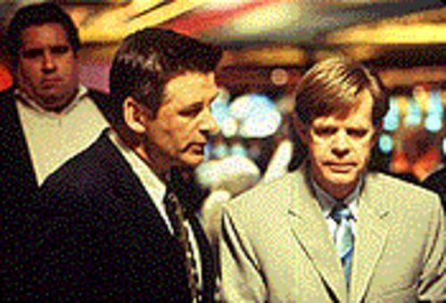 Gamblers anonymous: Alec Baldwin is the casino manager and William H. Macy is the debtor in The Cooler.