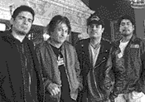 Fear in your beer: Lee Ving (second from left) and Fear march toward immortality.
