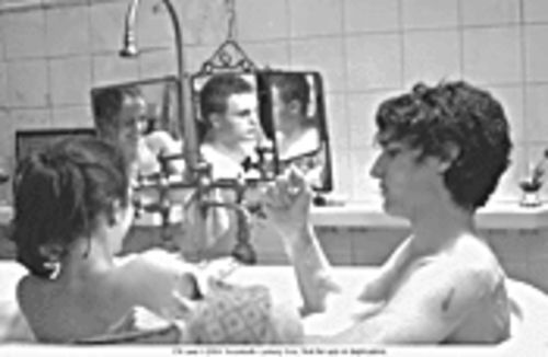 Three's not a crowd: Eva Green, Michael Pitt (reflection) and Louis Garrel in The Dreamers.