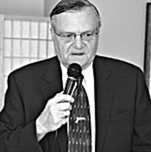 Microphone man: Arpaio in a familiar pose.