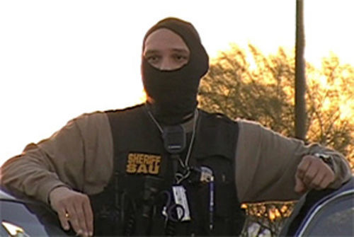 "One of the masked MSCO deputies who claimed to be ""undercover,"" while riding in a marked car."