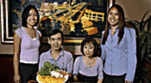 Viet eats: The Lam family, from left, daughter Julie, father Phan, mom Paulene, and daughter Emily.