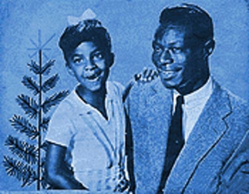 "A young Natalie Cole with her father: ""All I want for Christmas is my two front teeth - and all your signature songs."""