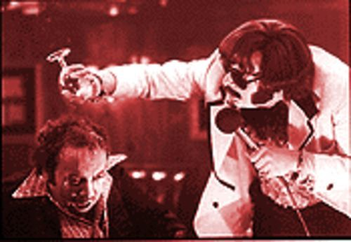 The unknown comic: Jim Carrey (right) dumps on Paul Giamatti in Man on the Moon.