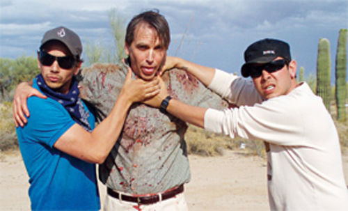 The Ronalds brothers with their hands on The Graves star Bill Moseley.