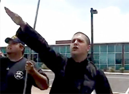 """Vito Lombardi"" and fellow neo-Nazi J.T. Ready flipping the fascist salute"
