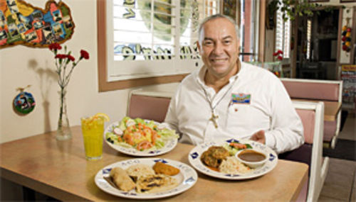Eliana's owner Jose Rosales serves Salvadoran specialties, including the tasty appetizer combo (foreground) with a pupusa, pastele, and tamale.