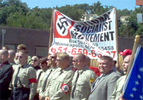Ready (second from right) participates in a National Socialist Movement rally in Omaha, Nebraska.