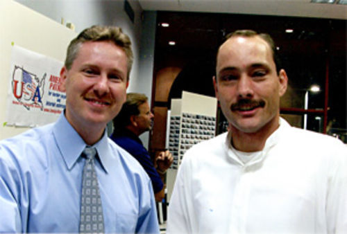 County Attorney Andrew Thomas (left) pays a visit to a U.S.A. meeting in 2006. U.S.A. founder Rusty Childress is seen in the background.