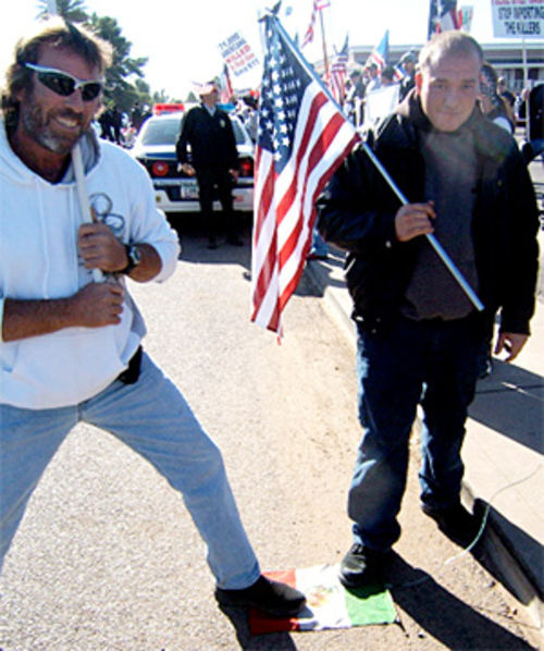 Demonstrators step on a Mexican flag during a 2007 protest at Pruitt's.