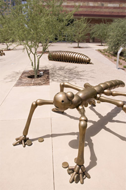 Two of three bronze insects that are part of Tom Otterness' Social Invertebrates