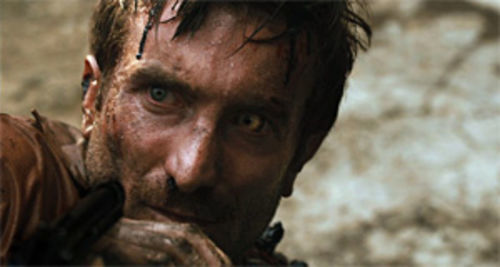 On the run: Sharlto Copley is both Dr. Richard Kimble and the one-armed man in District 9.