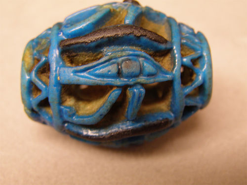 """Eye of Horus"" faience bead from Egypt, New Kingdom 1540-1075 BCE."