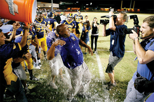 Coach Dansby was happily surprised by a cold Gatorade bath in the closing moments of the historic win.