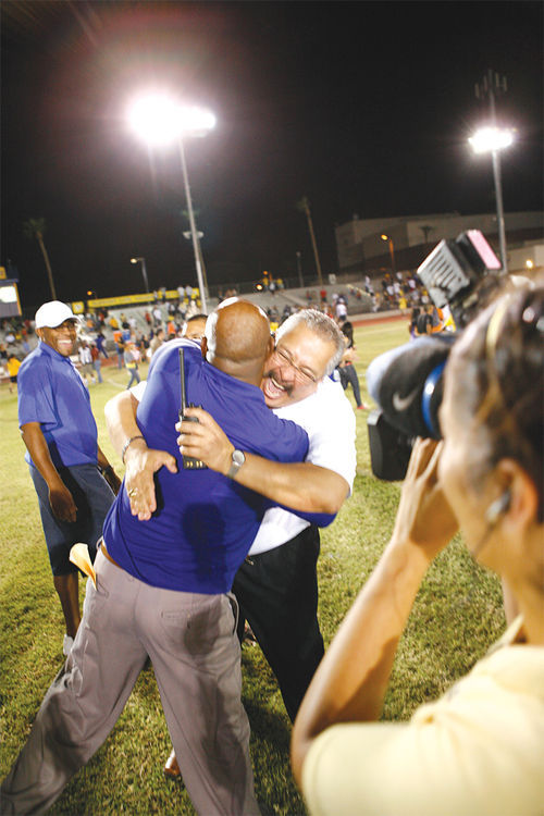 The end of The Streak. Coach Dansby and principal Steve Ybarra share a moment after the big win against the San Luis Sidewinders.