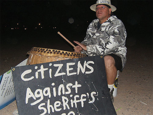 William Robles bangs his drum during his near-daily protest against the MCSO.