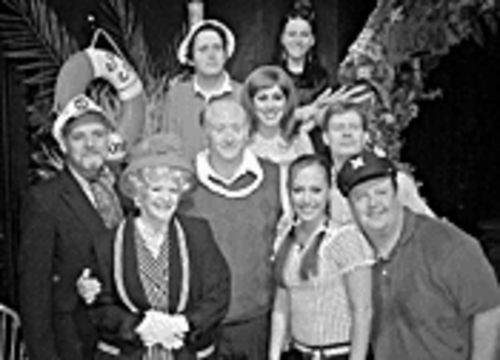 Lloyd Schwartz (center) gets lei'd by the Gilligan cast.
