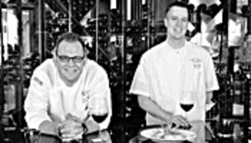 The sorcerer and his apprentice: Executive chef/co-owner James Porter and sous chef Kevin Lear, in front of Tapino's serpentine wall o' wine.