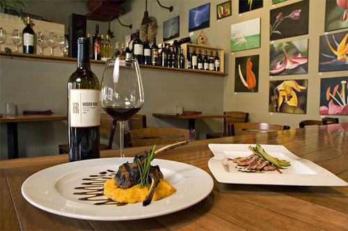 Stick with wine at D'Vine Bistro & Wine Bar, where the food is all over the map.