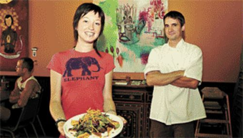 Vegan pleasin': Green manager Michelle Redman with a plate of jerk tofu salad, and owner Damon Brasch, the Dov Charney of PHX veg-dom.